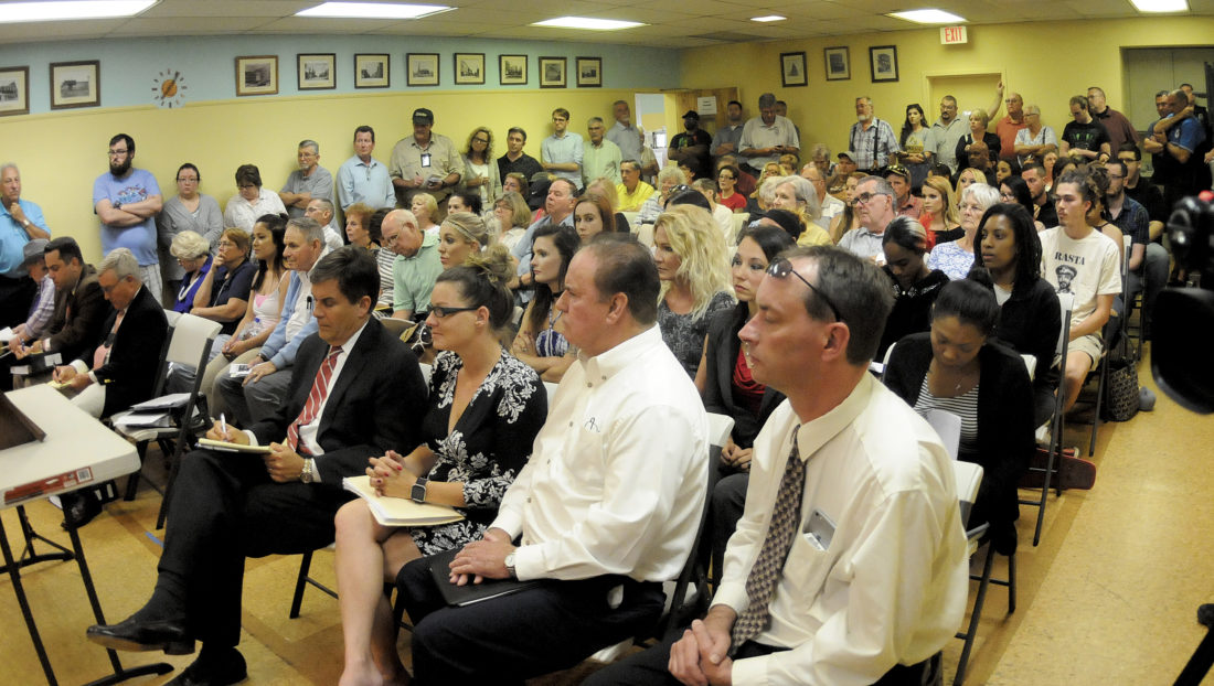 Wide shot at Taboo public hearing Tuesday evening in Martinsburg. A room divided with opposition on the left and supporters on the right.  (Journal Photo by Ron Agnir)