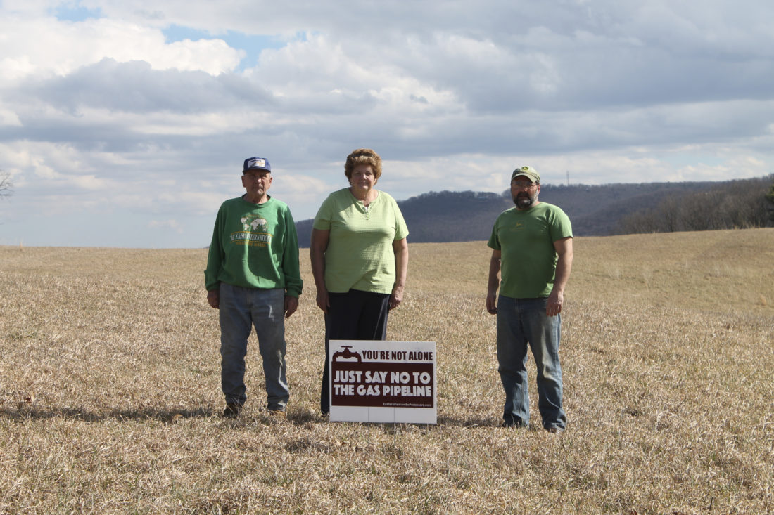 David Kerns and Patricia and Dean Kesecker stand in the field where Mountaineer Gas Company has proposed building their natural gas pipeline.