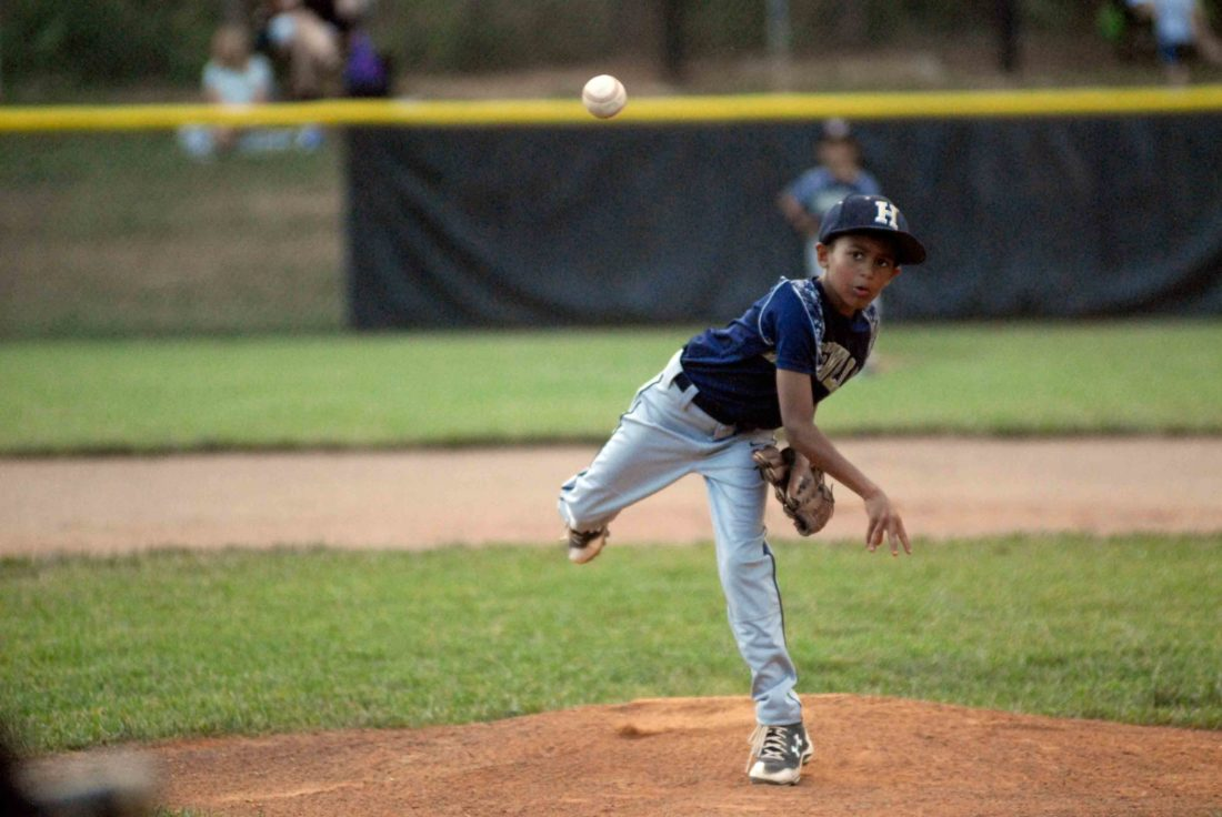 Akwasi Opoku-Achampong of Hedgesville delivers a pitch during the Battle at the Burg on Friday night. (Journal photo by Eric Jones)