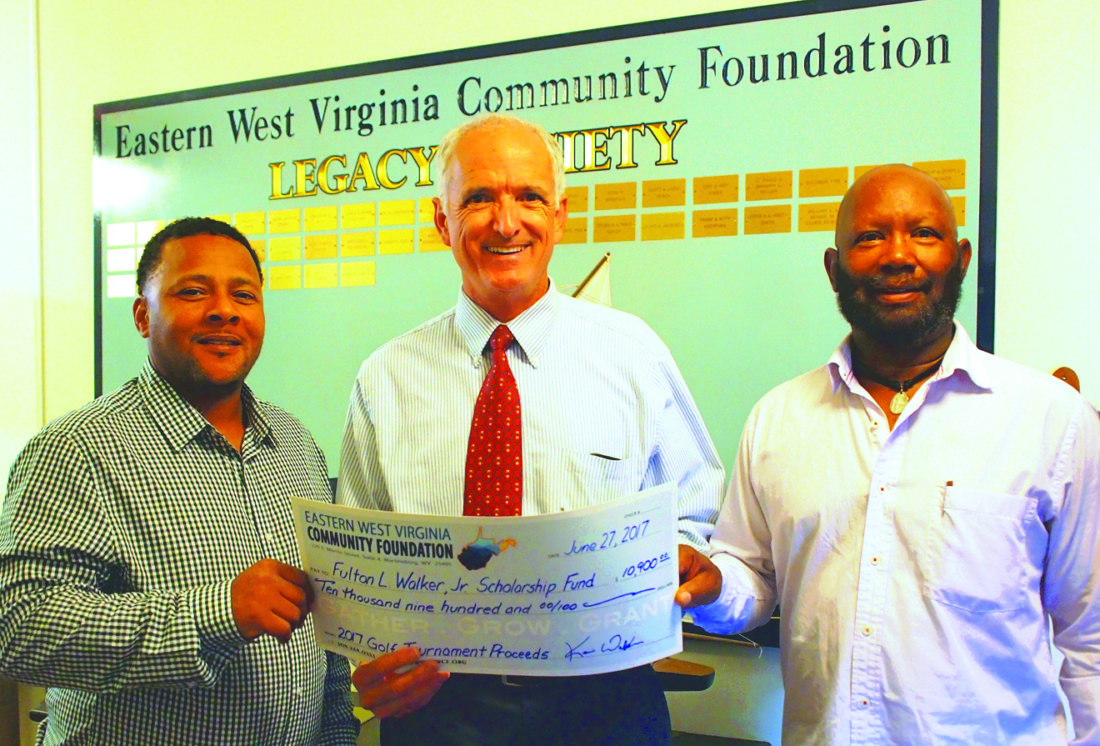 Journal photo by Jeff McCoy Pictured, from left, are committee member Kevin Walker; EWVCF Executive Director Michael Whalton; and Charles Mason with a check representing the funds raised at the Fulton L. Walker, Jr. Scholarship Golf Classic. Committee members not shown are Robert Sowell, Bertha Brown, Rick Pill, Paul Mason, and Gregg Wachtel.