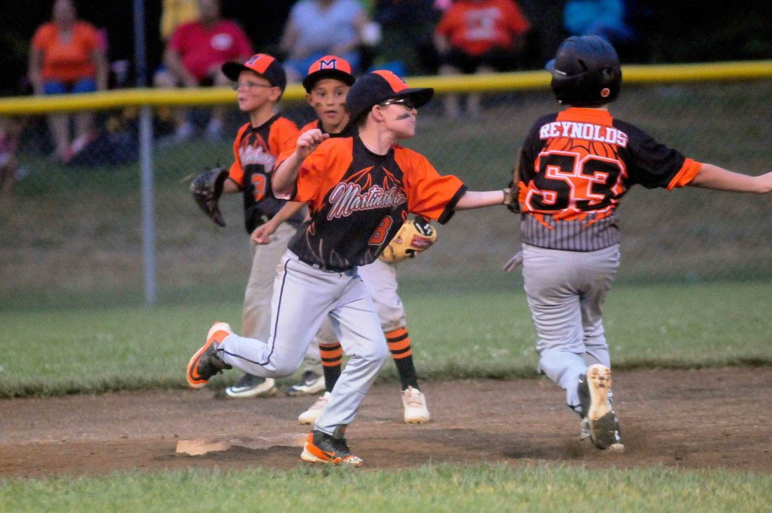 Martinsburg Black's Basey Fenton tags out Martinsburg Orange's Sean Reynolds near second base during the second inning of the Battle at the Burg Wednesday evening at Oatesdale Park. They'll try to resume a suspended game today. See more photos on CU.journal-news.net. (Journal photo by Ron Agnir)