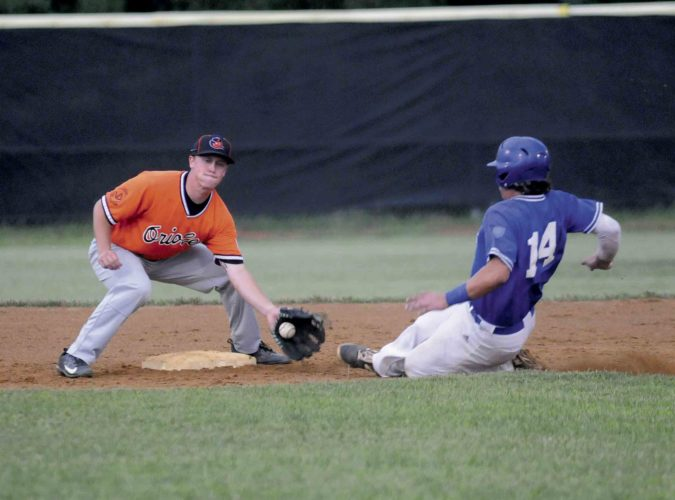 Journal photo by Ron Agnir Martinsburg's Darrin Zombro, right, slides under the tag attempt by Brunswick Orioles shortstop Taylor Itnyre on a passed ball during the second inning of Tuesday's game at P.O. Faulkner Park. See more photos on CU.journal-news.net.