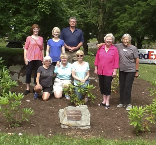 Members pose at the rhododendron grove created by the club in the War Memorial Park in Martinsburg in 2016. (Submitted photo)