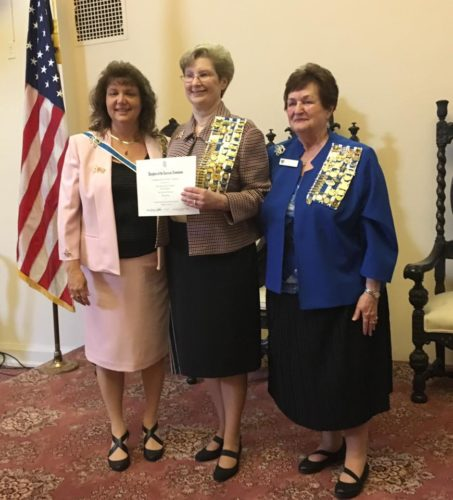 Shown receiving the award are, from left, State Regent Mindy Davis, Past Chapter Regent Cheryl Brown, and National Chair Carole Davis Levering, Commemorative Events Committee, NSDAR. (Submitted photo)