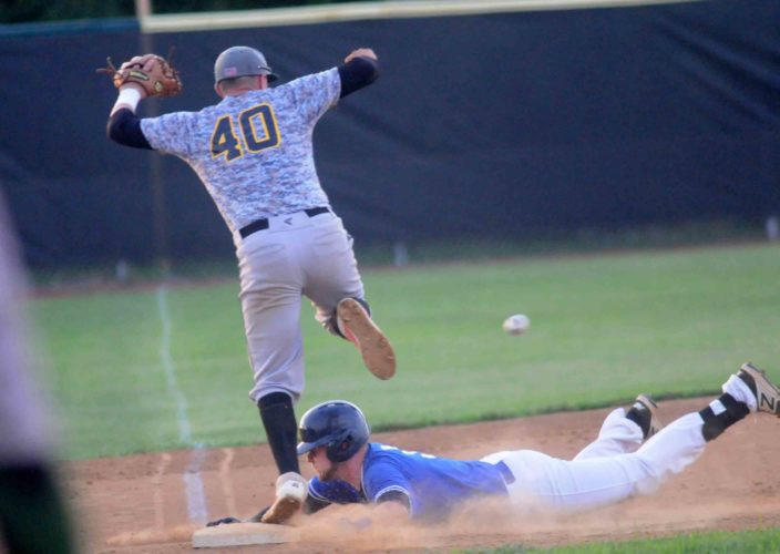 David Delawder of the Martinsburg Blue Sox slides into third base with a triple as West Virginia Pirates Justin Dailey  jumps during the fourth inning Thursday evening at P.O. Faulkner Park. See more photos on CU.joournal-news.net. (Journal photo by Ron Agnir)