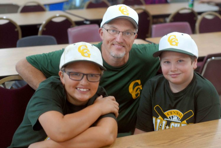 Journal photo by Rick Kozlowski Central Greenbrier Little League manager Pat Cochran, middle, sits with his son Joe, left, and Dylon Sheppard during a kickoff picnic for the 9-11-year-old state tournament.