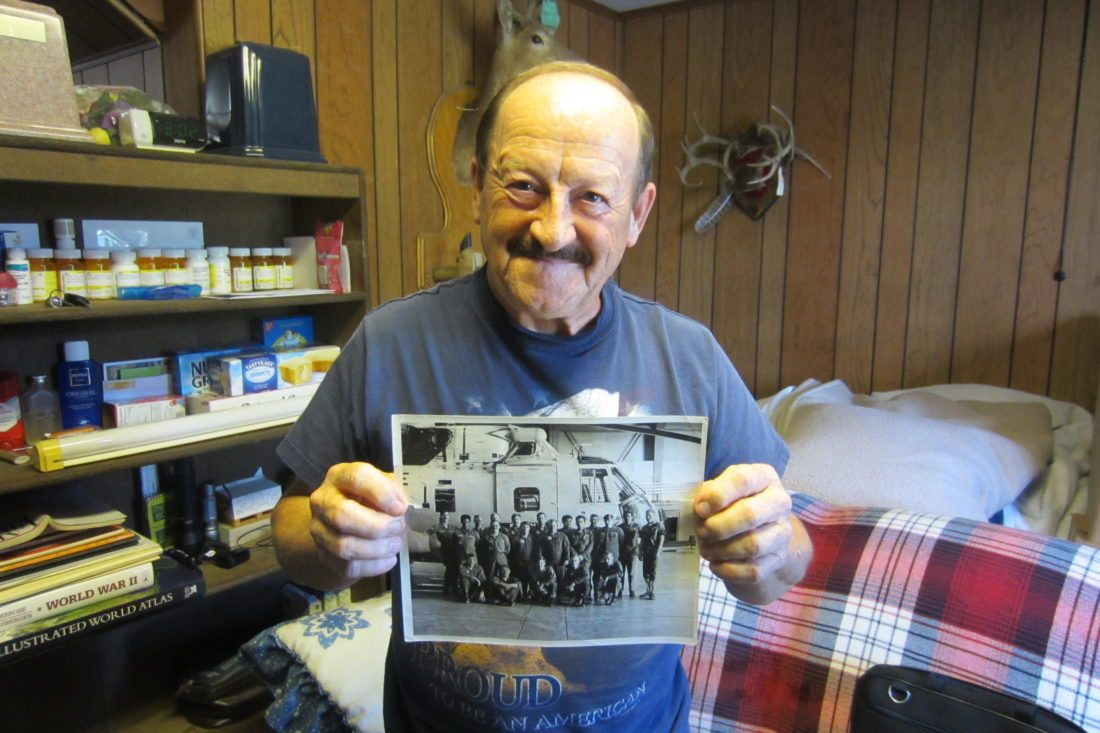 Howard C. Prevost Jr. of Berkeley Springs shows a photo of him and his comrades with the 37th Aerospace Rescue and Recovery Squadron in Thule, Greenland in 1970s.