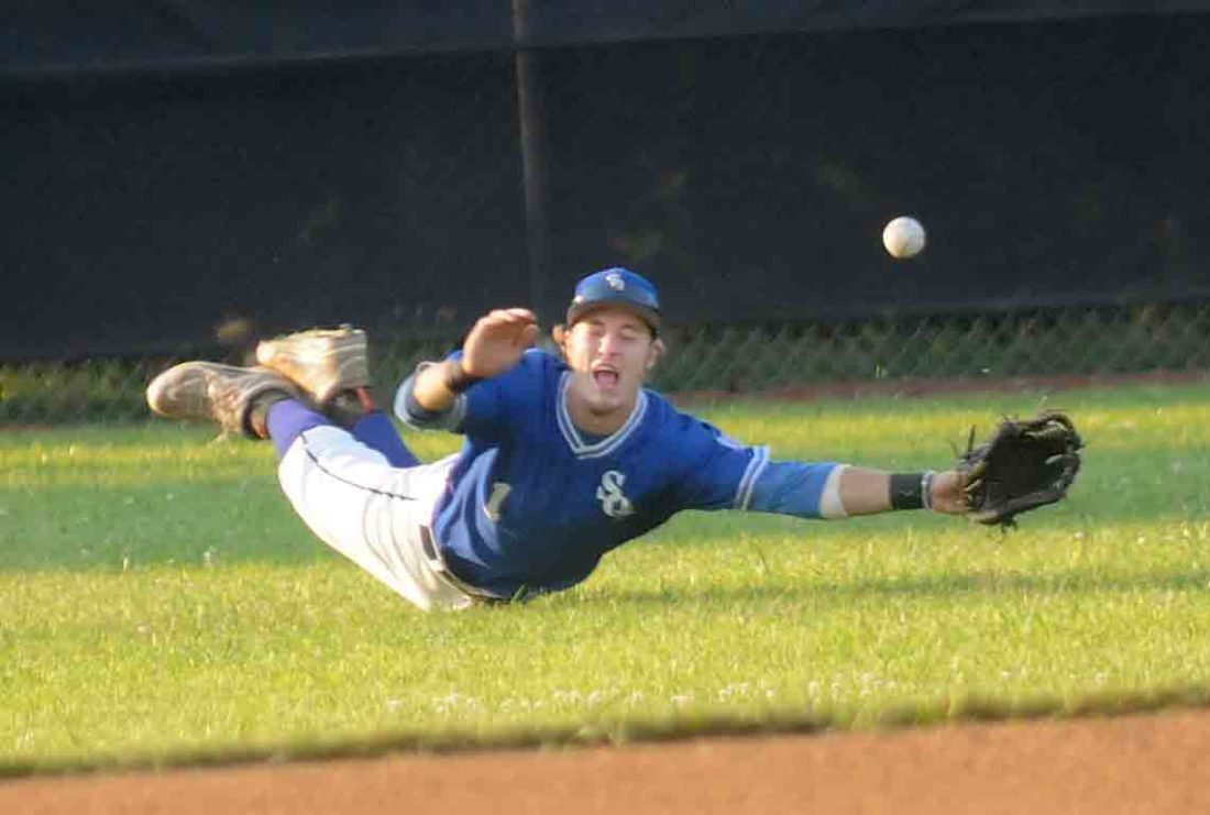 Martinsburg Blue Sox outfielder Zeke Grissinger lunges but can't snag a blooper into shallow left field during the first inning of the Blue Ridge League playoffs. (Journal photo by Ron Agnir)