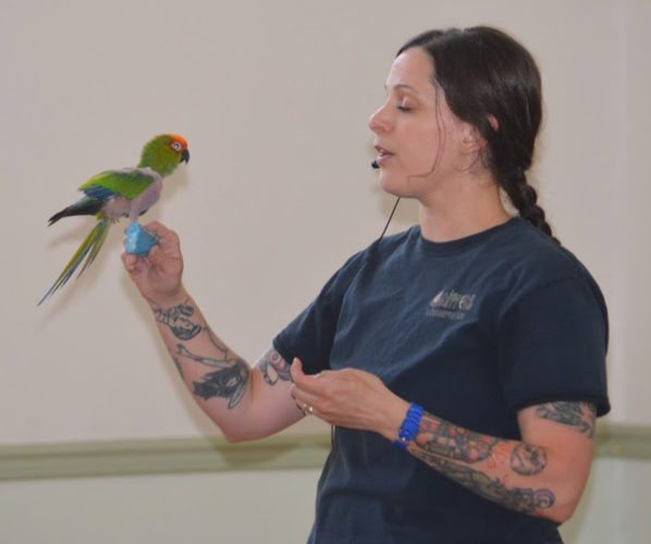 Jill Fleet of Critters and Conversation shows Tiki the gold caped conure to local children of Shepherdstown. (Journal photo by Adranisha Stephens)