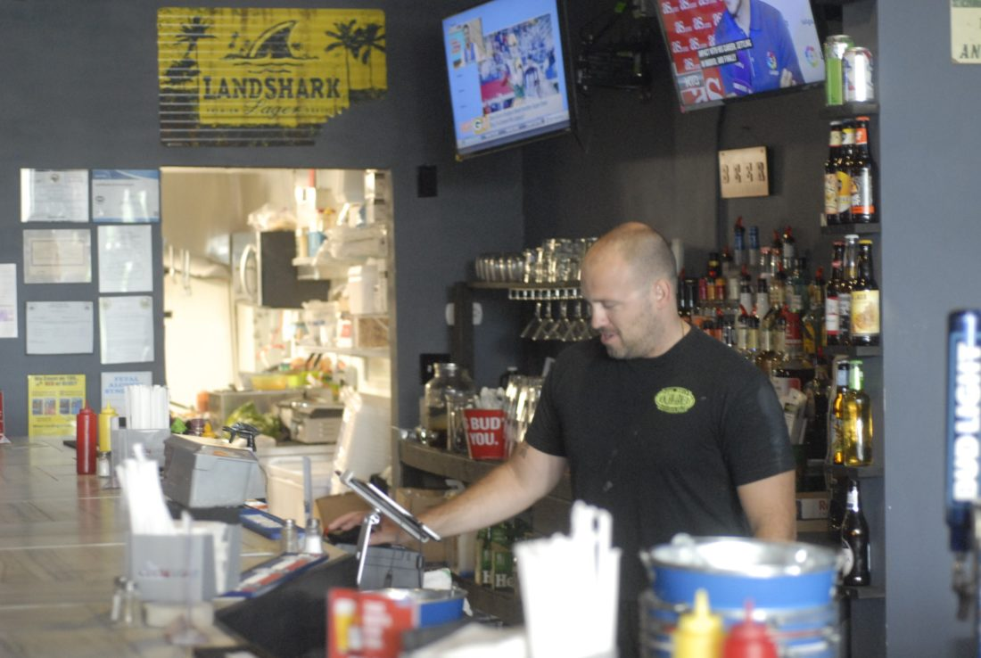 Pictured is Tom Lake, owner of Benchwarmers, working behind the bar. (Journal photo by David Craft)