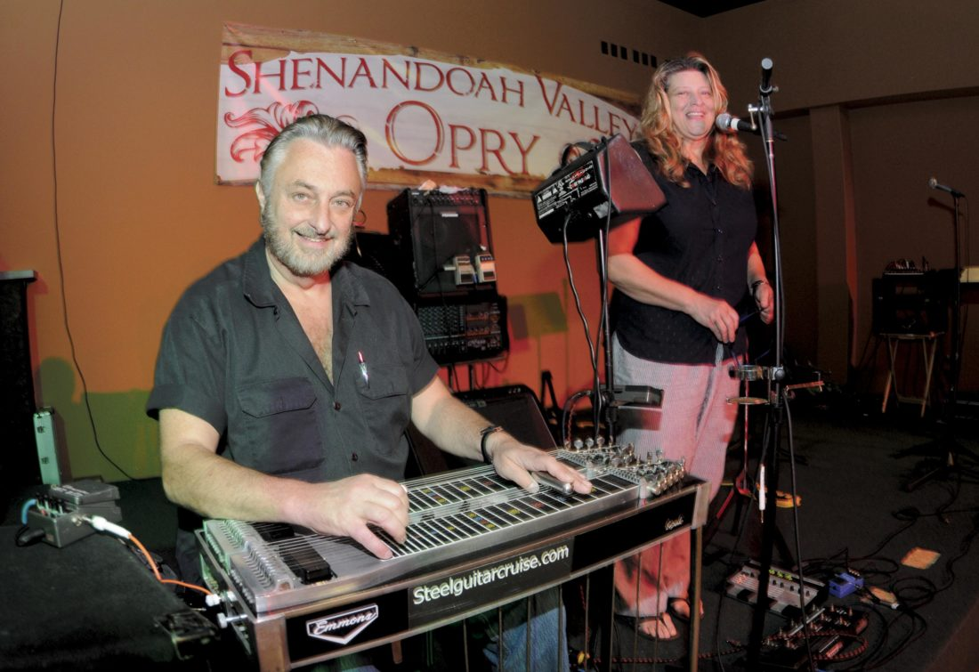 Jim and Melanie Hodge on stage at the Shenandoah Valley Opry in Martinsburg. (Journal Photo by Ron Agnir)