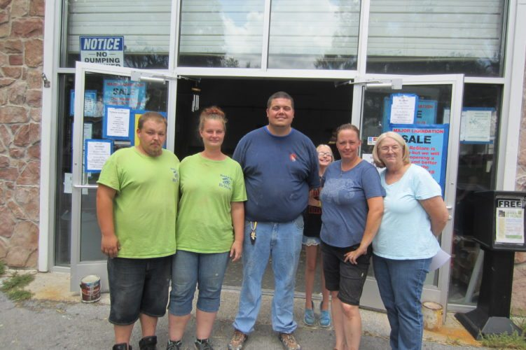 Habitat for Humanities of the Eastern Panhandle' used home-materials store, ReStore on West Race Street, is closing temporarily. Habitat officials plan to reopen the store at another location next spring. From left at the current store are Andrew Johnson, the store's cashier; Bessie Push, a store volunteer; Jason Baker, Habitat president; Jessica Stewart, store manager; and Karen Fairall, Habitat's office manager. (Journal photo by Tim Cook)