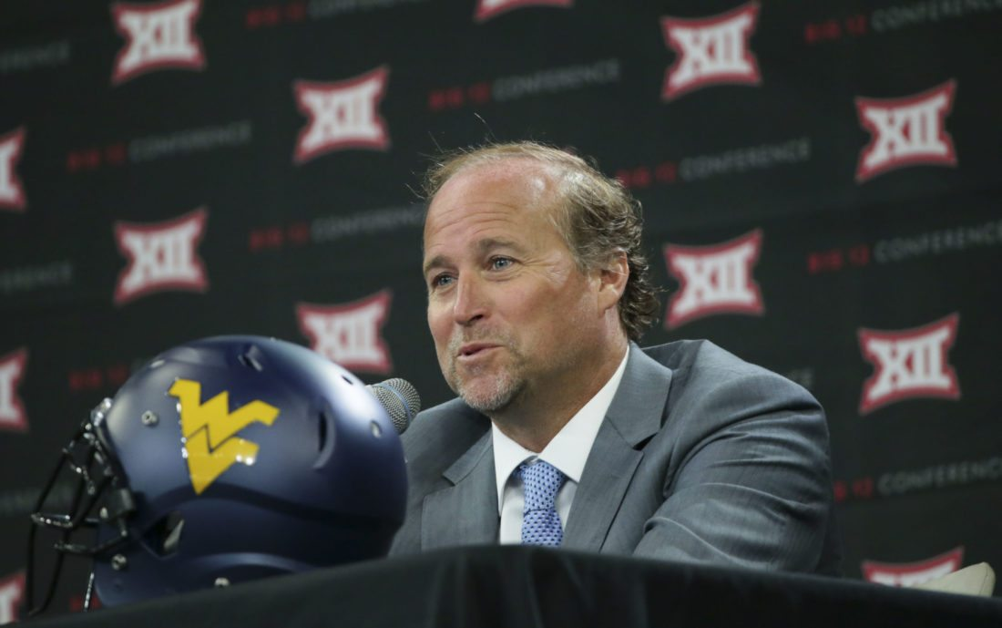 West Virginia head football coach Dana Holgorsen speaks to reporters during the Big 12 media day in Frisco, Texas, on July 18.