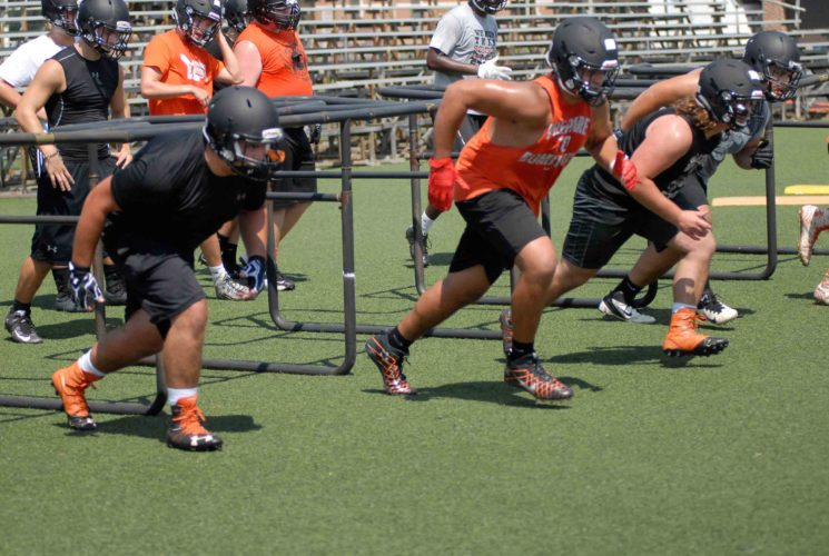 Martinsburg linemen run through a drill during the Bulldogs' first practice of the season on Monday. The Bulldogs will be on the hunt for a second straight Class AAA state championship this season. (Journal photo by Rick Kozlowski)