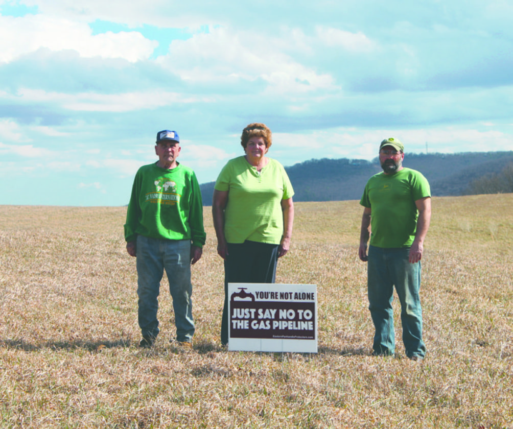 David Kerns and Patricia and Dean Kesecker stand in the field where Mountaineer Gas Company has proposed building their natural gas pipeline. (Journal photo by Danyel VanReenen)