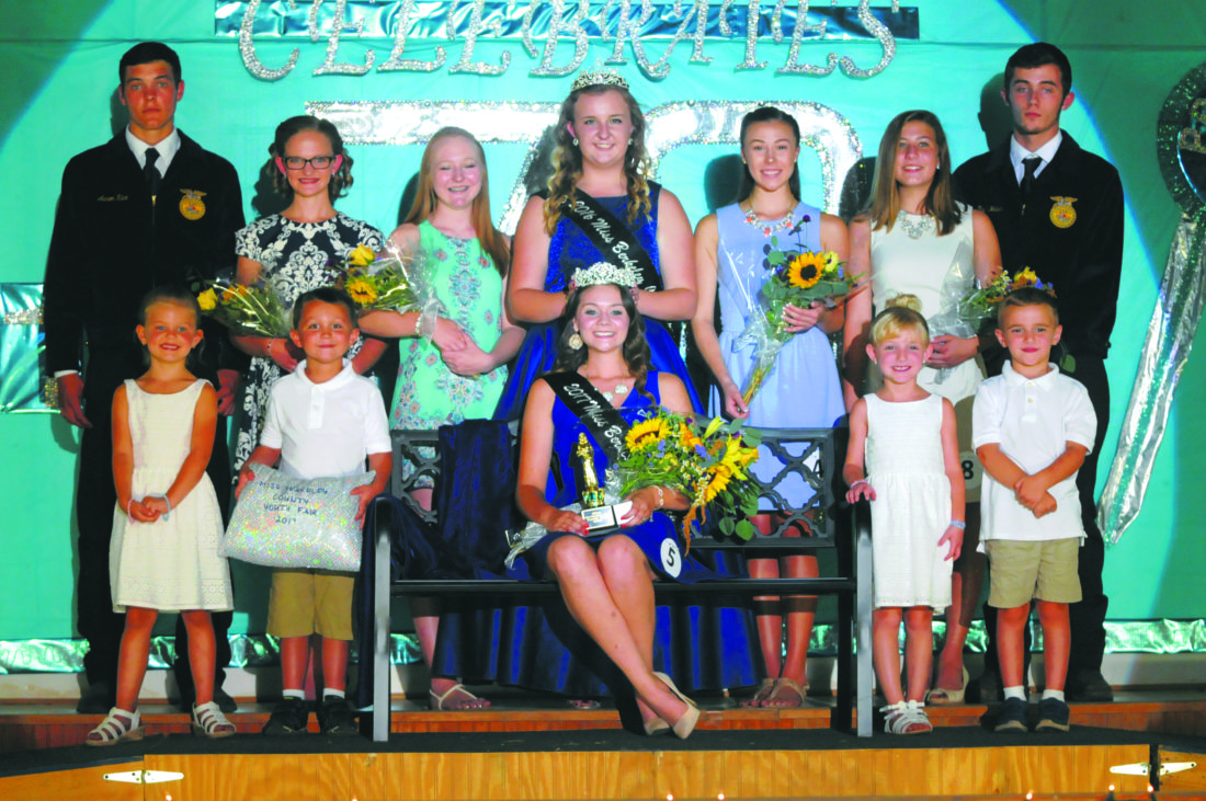 Journal photo by Ron Agnir Elizabeth Lynch, seated center, is shown with her court on Friday night at the Berkeley County Youth Fair. Front row, from left, are Samantha Silkworth, Hunter Ware, Cate Horner and Brayden McDonald. Back row, from left, are Aaron Rice, Mallorie Rudy, third runnerup; Allexis Canby, first runnerup; Shelby Silveous, 2016 queen; Taylor Barrett, second runnerup; Jewelia Tabler, fourth runnerup; and Chris Rankin. See more photos on CU.journal-news.net.