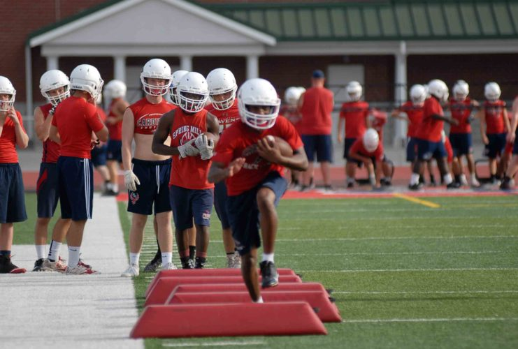 Journal photo by Jessica Manuel Spring Mills' running backs work through drills earlier this week during afternoon practice. TheCardinals are in search of their third straight appearance in theClass AAA playoffs.