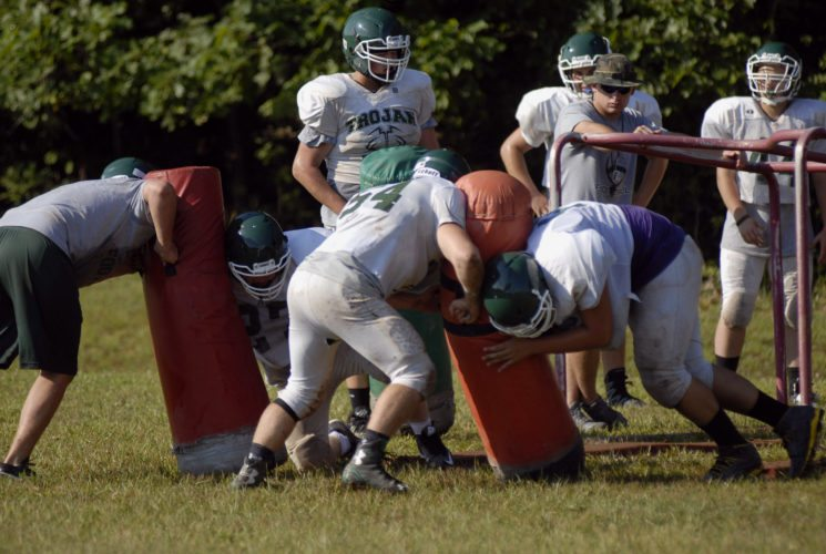 Journal photo by Jessica Manuel Members of the Hampshire football team's offensive line work through drills during the first week of practice. The Trojans are looking to improve on a two-win season in 2016.