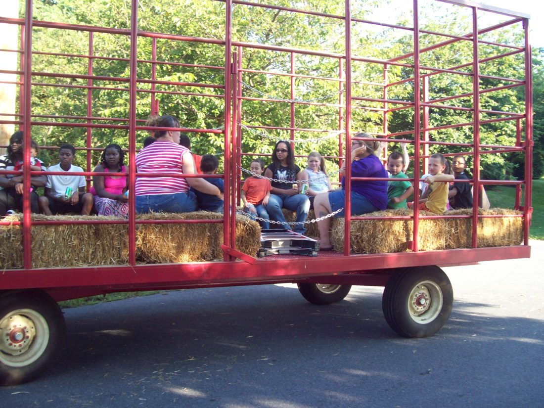 Pictured are families from the community going on hayrides at the annual Martins Landing and Timberleaf Block Party.