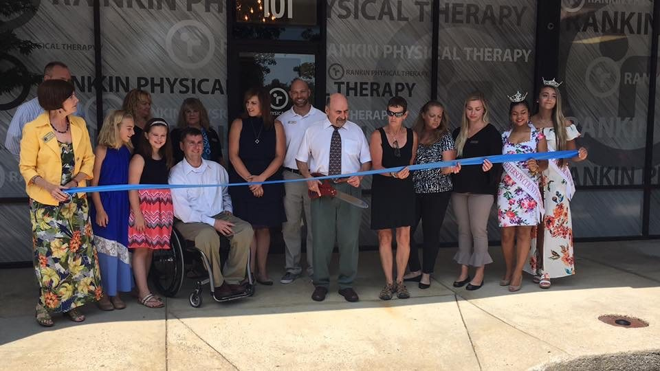 Mayor Auxer of Shepherdstown and Rankin Physical Therapy staff perform a ribbon cutting at its newest location in Shepherdstown.