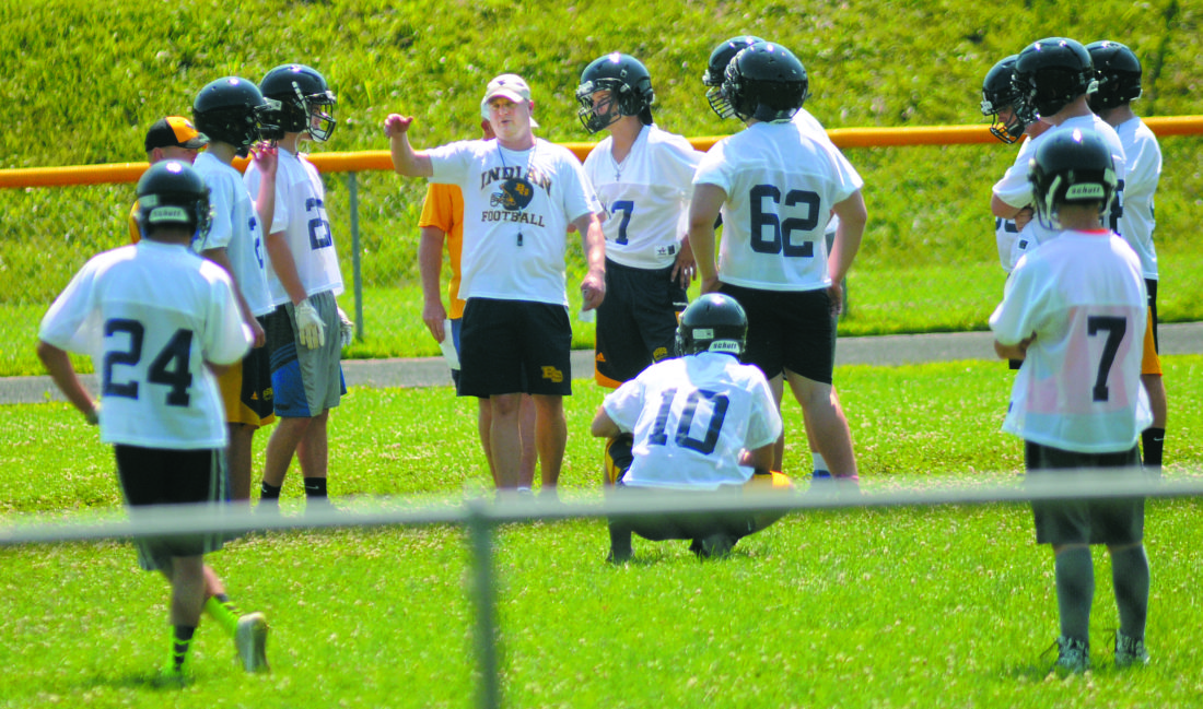 Journal photo by Ron Agnir Berkeley Springs football coach Matt Puffenberger, middle, instructs players during practice last week. The Indians have high hopes of making the playoffs this season for the first time in a decade.