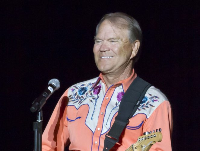 """FILE - This Sept. 6, 2012 file photo shows singer Glen Campbell performing during his Goodbye Tour in Little Rock, Ark. Campbell, the grinning, high-pitched entertainer who had such hits as """"Rhinestone Cowboy"""" and spanned country, pop, television and movies, died Tuesday, Aug. 8, 2017. He was 81. Campbell announced in June 2011 that he had been diagnosed with Alzheimer's disease. (AP Photo/Danny Johnston, File)"""