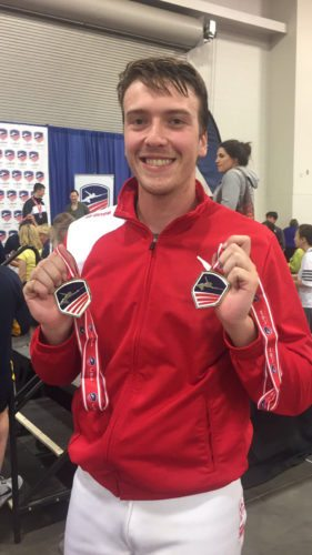 William Snyder, of Shepherdstown, poses with his medals from the USA Fencing National Championship. He earned first Division IIMen's Epee.