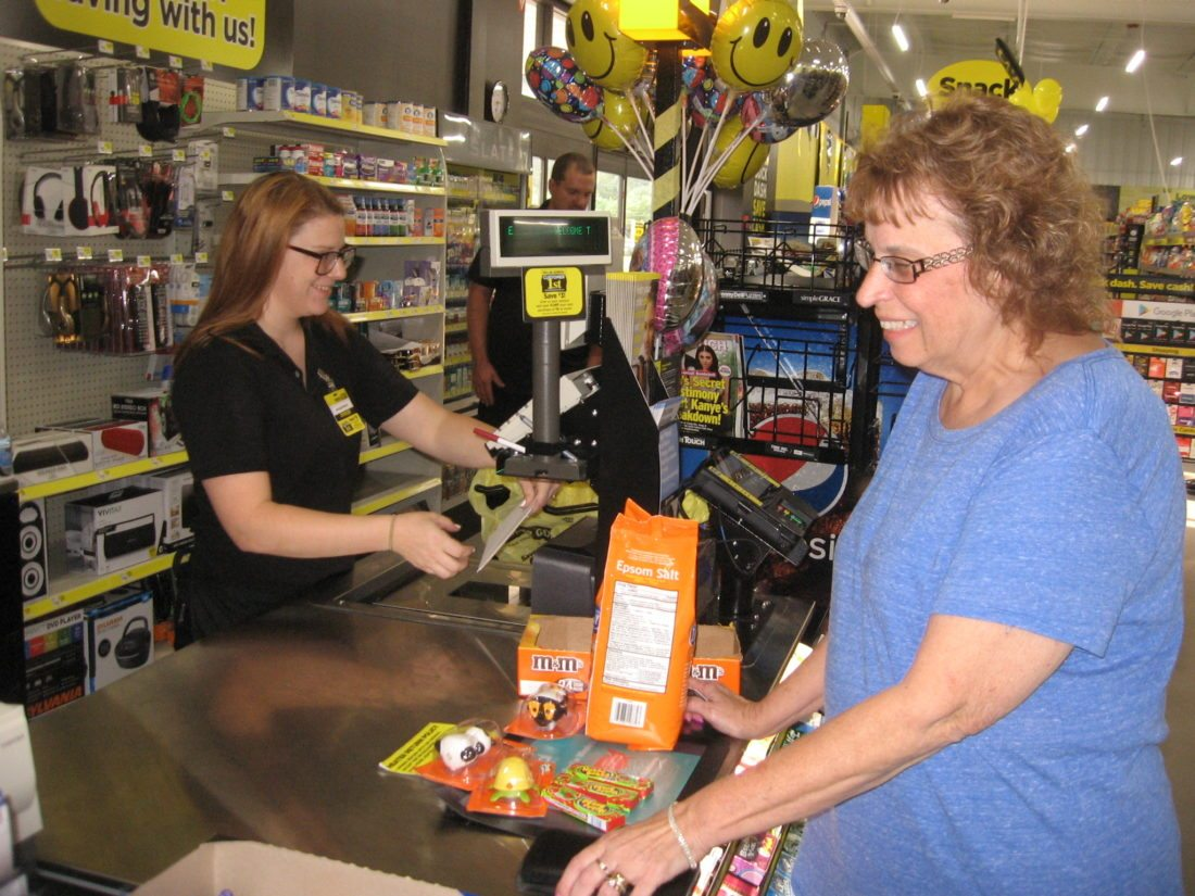 Assistant Store Manager Kndra Baxter and customer Carol Frye at Dollar General's recent grand opening at Oakland Road, Berkeley Springs.