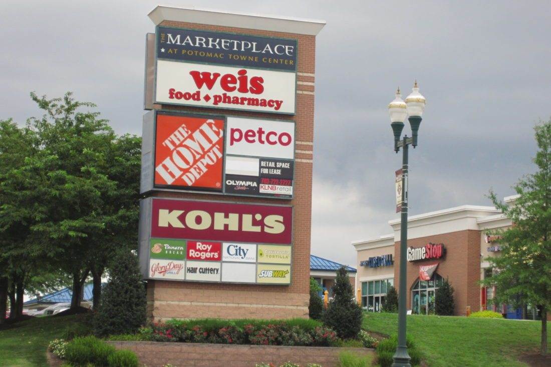 The shopping center entrance sign to the Marketplace at Potomac Towne Center, which now has a new owner.