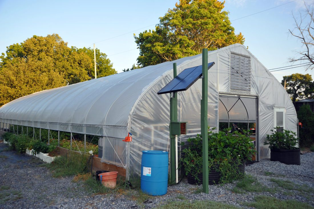 A greenhouse is used in addition to outdoor raised bed gardens for the public to grow fresh and healthy vegetables for their families and the community. Free classes have been offered throughout the season and the last one for this period will be held on today at 6 p.m. (Journal photo by Jeff McCoy)