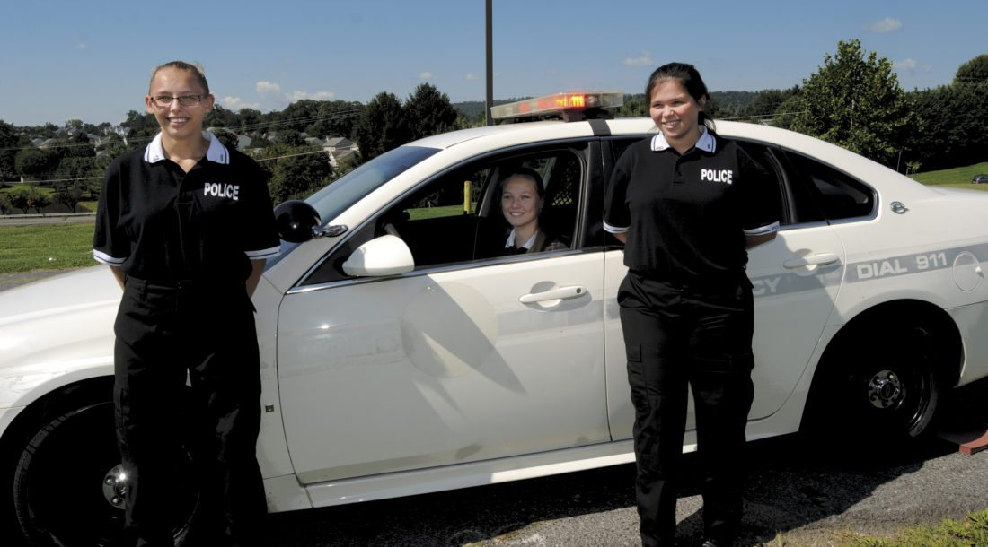 From left: Criminal Justice Program student leaders Lt. Elizabeth Casteel, Captain Cheyenne Putnam and Jasmine Murphy withe the 2009 Chevy Impala Police Cruiser at James Rumsey Technical Institute Thursday morning in Hedgesville. (Journal Photo by Ron Agnir)