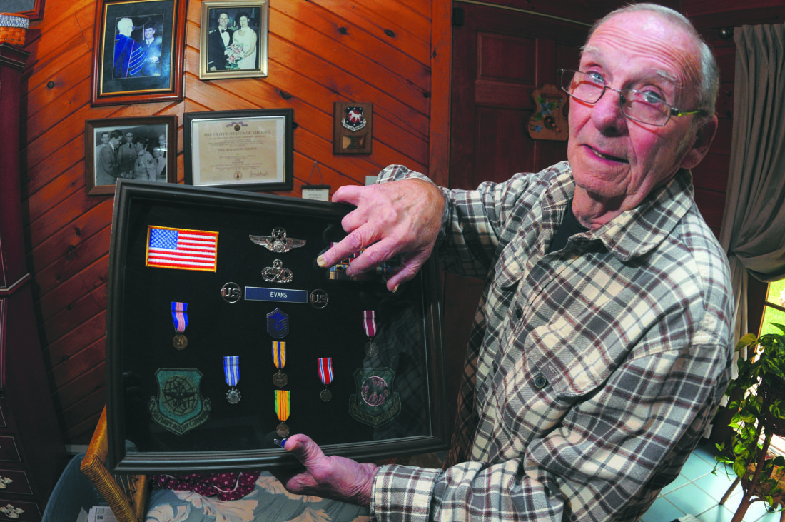 "Kenneth Evans displays his service medals and patches. He is especially proud of the Air Force Maintenance Badge abouve his name. ""All the men and women I worked with were like brothers and sisters."" (Journal Photo by Ron Agnir)"