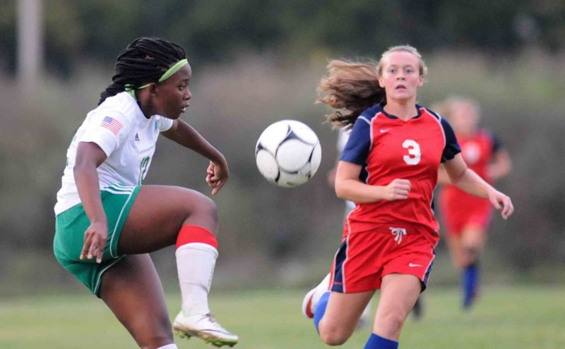 Musselman's Zanale Nyabusha, left, clears the ball in front of Spring Mills' Madelyn Hearn the first half of their game on Thursday. See more photos on CU.journal-news-net. (Journal photo by Ron Agnir)