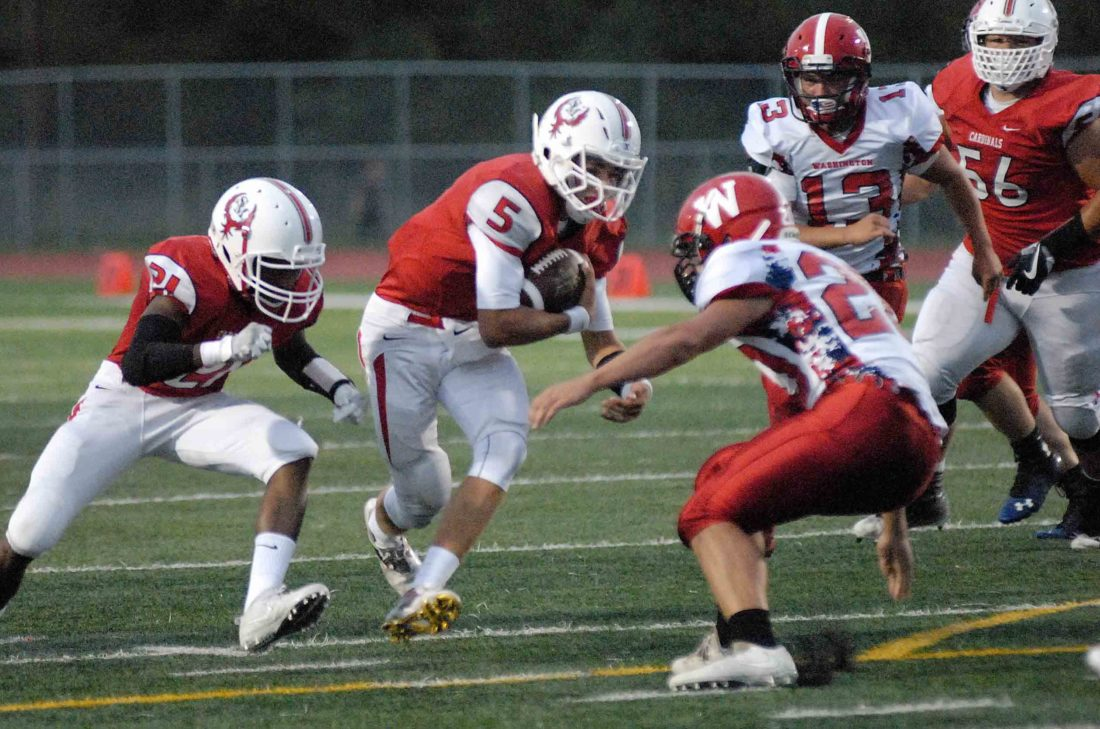 Spring Mills quarterback Evin Hurt lowers his shoulder to run at Washington's Spencer Delawder Friday night. See more photos on CU.journal-news.net. (Journal photo by Eric Jones)