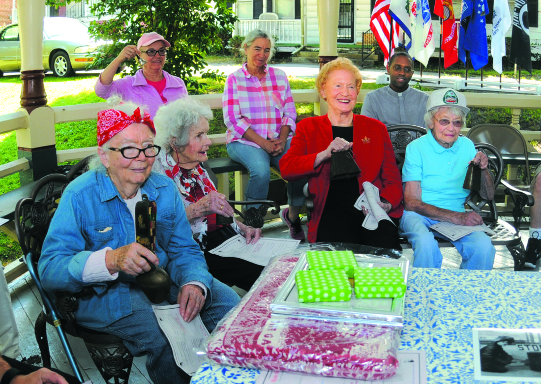 """05 Labor Day Rosies ra 09-04-17 From left: real life Rosies ..... Dorothy Davenport, Ada M. England, Gladys M. Rockenbaugh and Agatha """"Pete"""" Murphy, ring bells at 1:00PM acknowledging their service they performed for the US where they worked as welders, riveters, Navy Nurse and supply support staff back during WWII. The 90+ year old ladies were being honored as Rosie the Rivetters during a ceremony in Harpers Ferry Monday afternoon. (Journal Photo by Ron Agnir)"""