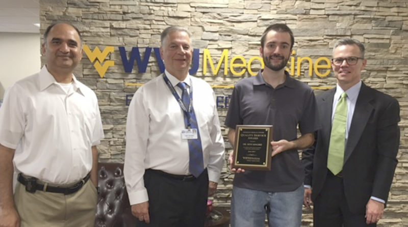WVU Medicine Berkeley Medical Center's June Quality Service Award winner is pictured receiving his award.  Left to right: Hospitalist Gaurav Parikh, MD; President and Chief Executive Officer Anthony P. Zelenka; June QSA Winner Seth Kingree, MD; and Sound Physicians Regional Medical Director J. Scott McLavy, MD. (Submitted photo )