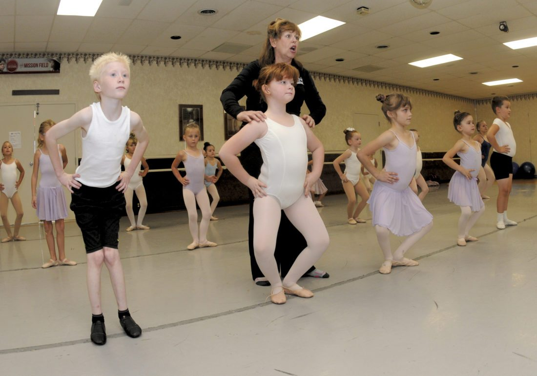 Deena Smith, artistic director at Inwood Performing Arts Company, teaches from left: Patrick LeMaster, 9; Alisha LeMaster, 8; Miracle LeMaster, 8 and Destiny LeMaster, 6 during a Ballet I class Tuesday evening in Inwood. (Journal Photo by Ron Agnir)