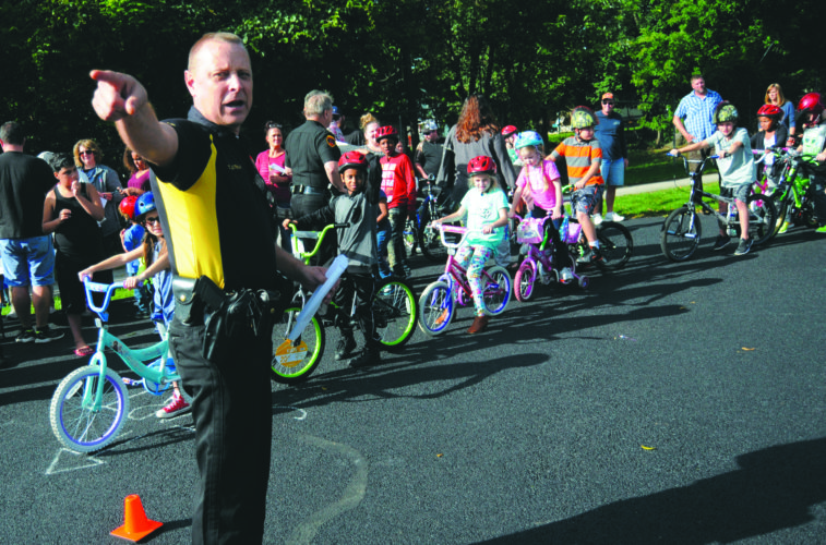 08 Bicycle Rodeo2 ra 09-07-17 Todd Lutman, Lieutenant-Ranson Police Department, instructs the youth bicyclists how to navigate the obstacle course at a Bicycle Rodeo Safety Awarenes Community Program sponsored by WVU Medicine Jefferson Medical Center and the Ranson Police Department at Ranson Elementary School   Thursday afternoon. See more photos on CU.journal-news.net. (Journal Photo by Ron Agnir)