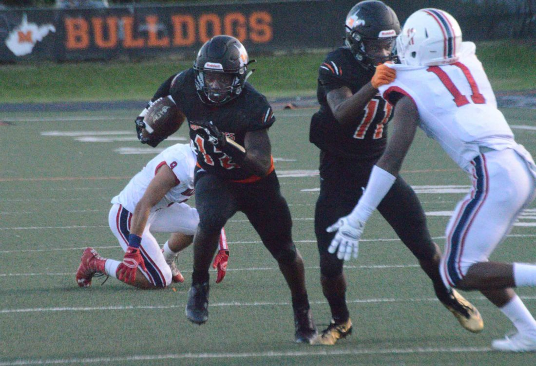 Martinsburg's Shy Crawford, left, takes the ball to the end zone for a 17-yard touchdown as teammate Michael Boaitey blocks Liberty Christian's Kameron Knowles in the first quarter of their game on Friday. (Journal photo by Jessica Manuel)