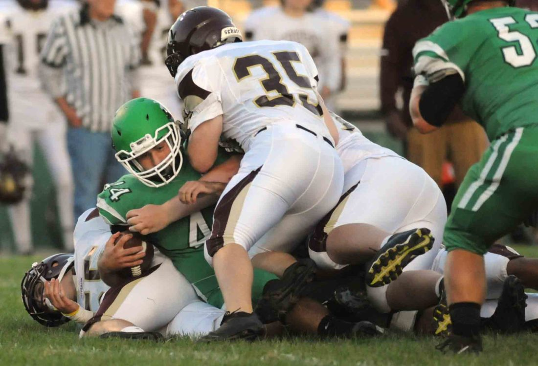 Musselman's Jacob Northcraft is tackled after a gain on a night in which he set the school's career rushing record. (Journal photo by Ron Agnir)