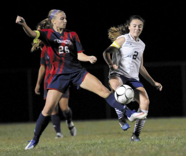 Washington's Mikayla Azar, left, and Hedgesville's Rachel Rodriguez battle for the ball during the first half Tuesday at Poisal Park Tuesday evening. See more photos on CU.journal-news.net.  (Journal photo by Ron Agnir)