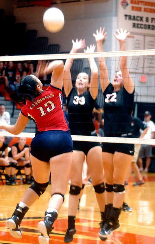 Springs Mills' Jazmyn Mauck spikes as Martinsburg's Carly Smith (33) and Abigial  Joseph (22) attempt to block Tuesday evening at Martinsburg. See more photos on CU.journal-news.net.  (Journal photo by Eric Jones)