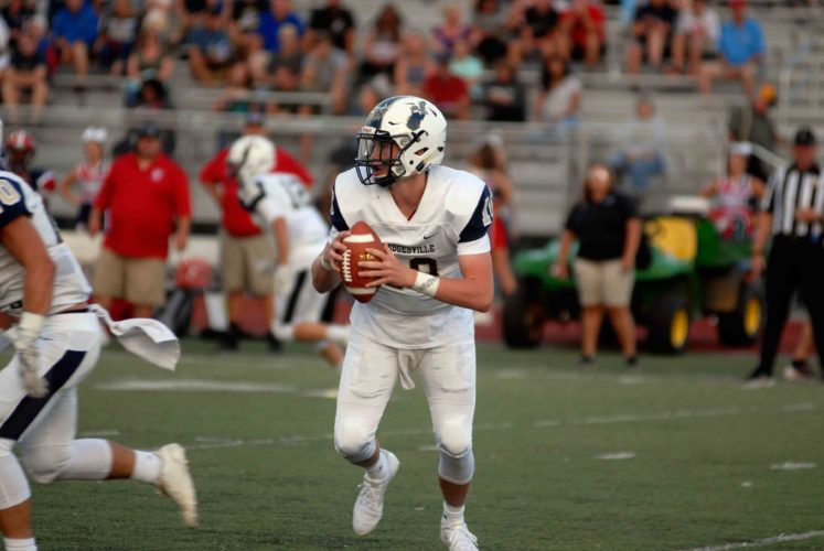 Journal photo by Rick Kozlowski Hedgesville quarterback Jason Plotner threw for 406 yards and six touchdowns in the Eagles' win over Mountain Ridge, Maryland.