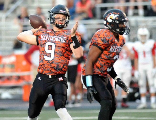 Journal photo by Ron Agnir Protected by Martinsburg's Dewayne Grantham, quarterback Tyson Bagent throws a 24-yard touchdown pass against Springs Mills during the first quarter Friday evening at Cobourn Field. See more photos on CU.journal-news.net.