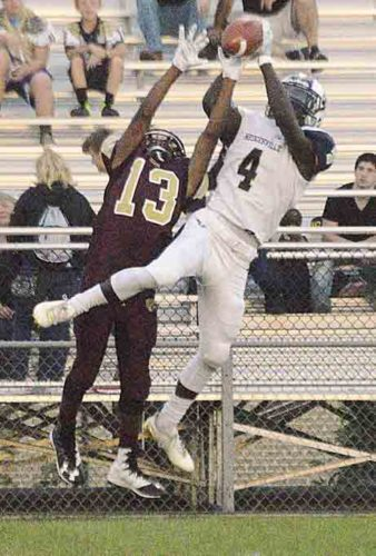 Journal photo by Jessica Manuel Hedgesvile's N'yjere Smith (4) catches a pass over Jefferson's Jon Gidney Friday night.
