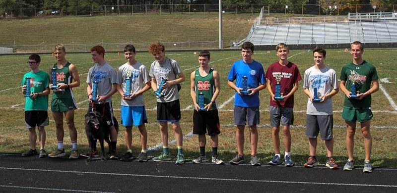 Above, the top 10 boys from the Frankfort Invitational pose with their trophies. Included in the top 10 are Musselman's Hunter Reed, Asher Personett, Sam Garrett and Evan Penrose. Below, the top 10 girls from the Frankfort Invitational pose together. Included are Musselman's Jessie Dailey, Jodi Chwalik, Charley Longerbeam, Kelly Elkins and Christina Napier.