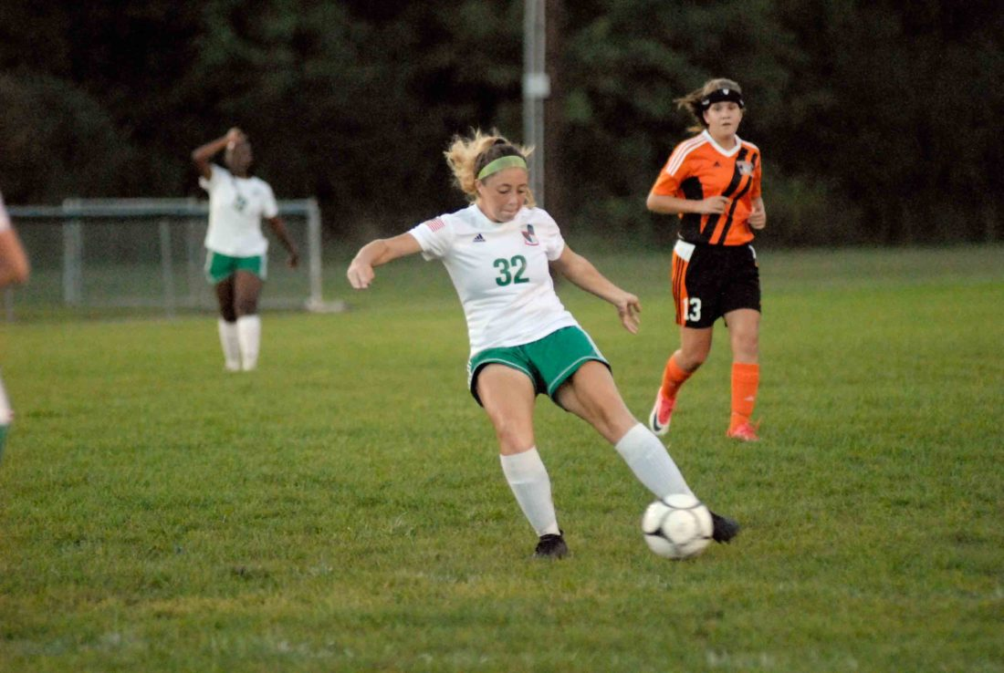 Kaliegh Vaca of Musselman controls the ball in front of Martinsburg's Emily Beck during the Applemen's victory on Tuesday. Vaca scored four goals. (Journal photo by Eric Jones)