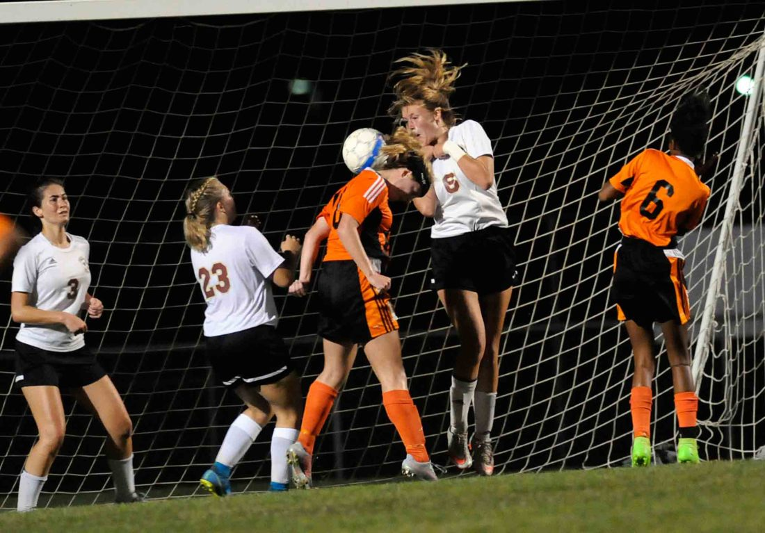 AP photo Martinsburg's Marina Laub slips in between Jefferson's Kailey Cullen (23) and Laura Barrat (6) to head the corner kick into the goal for the game-winner late Thursday night in Shenandoah Junction. See more photos on CU.journal-news.net.