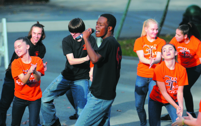 Derrick Twyman sings and dance with the Martinsburg High School Good Times Show Choir at the Olweus Community Kickoff at War Memorial Park Thursday afternoon in Martinsburg. See more photos on CU.journal-news.net. (Journal Photo by Ron Agnir)