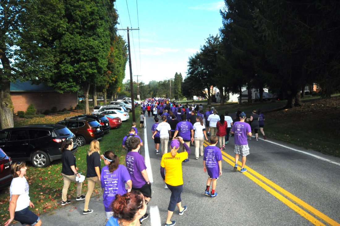 Journal photo by Jeff McCoy Walkers form a line at the Alzheimer's Association's Walk To End Alzheimer's event Saturday, in Martinsburg.